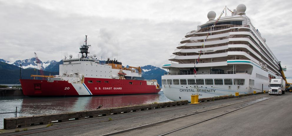 The U.S. Coast Guard Cutter Healy is docked next to the Crystal Serenity luxury cruise ship in Seward on Tuesday, August 16, 2016. It was the start of the journey for the Serenity, which planned to cross the Northwest Passage on its way to New York City. (Marc Lester / Alaska Dispatch News)