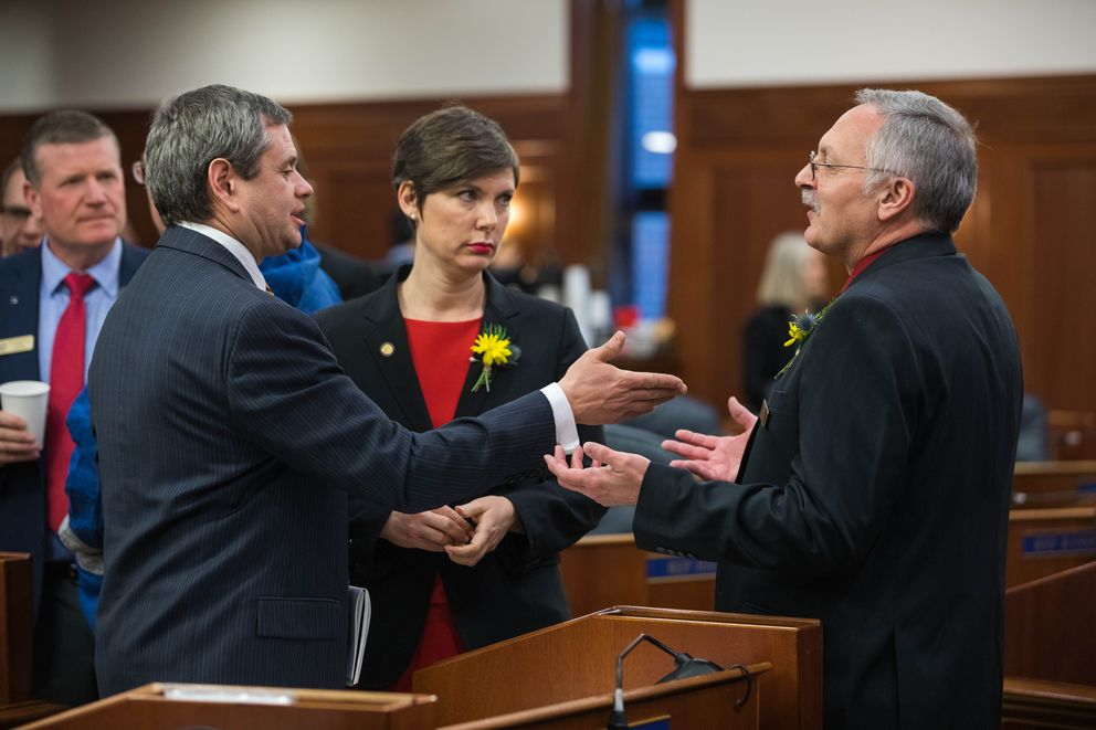Rep. Chris Tuck, D-Anchorage, left, and Rep. David Talerico, R-Healy, discuss the rules of order during an at ease on Tuesday. Talerico tried to make a motion to seat Sharon Jackson, who the Governor had appointed to fill a seat vacated by Nancy Dahlstrom, who left for a job in the executive branch, but Tuck objected saying that the House first needed to vote on a Speaker Pro Tem. (Loren Holmes / ADN)