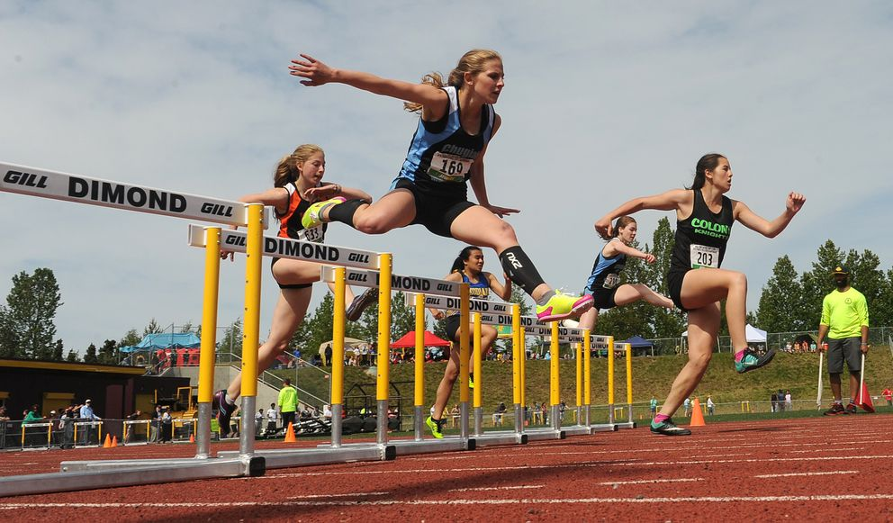Class 4A runners compete in the girls' 300-meter hurdles Friday at Dimond. (Bob Hallinen / Alaska Dispatch News)