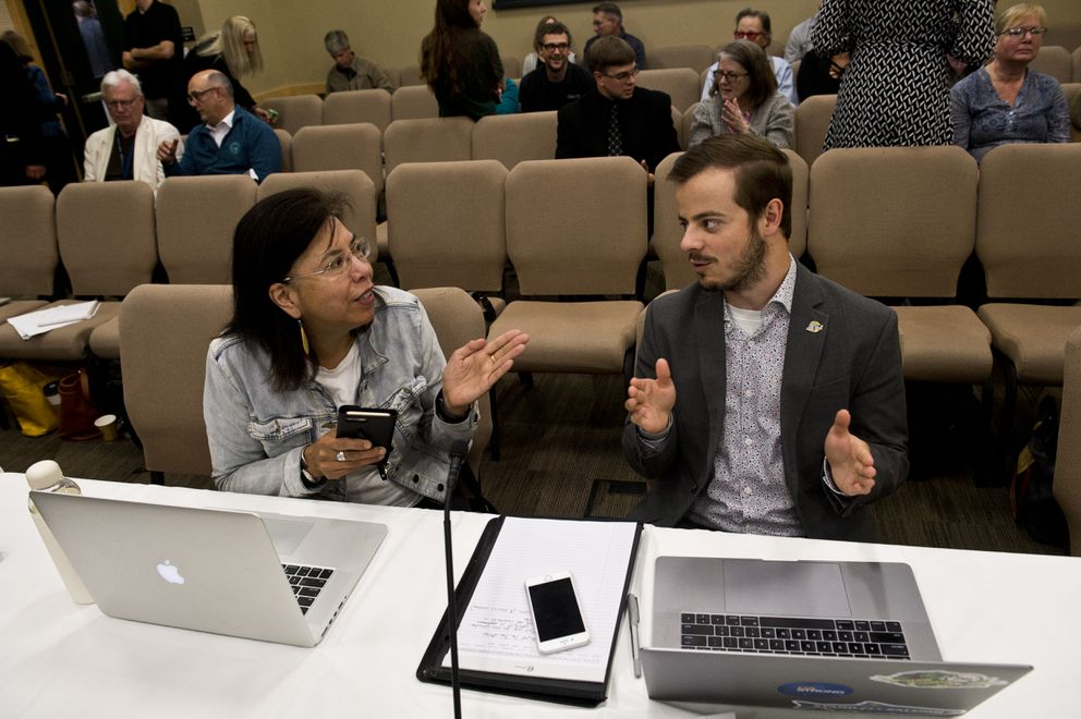 Maria Williams, a professor of Alaska Native studies at UAA who chairs UA's Faculty Alliance, left, talks with Union of Students representative Alex Jorgensen during a break. (Marc Lester / ADN)