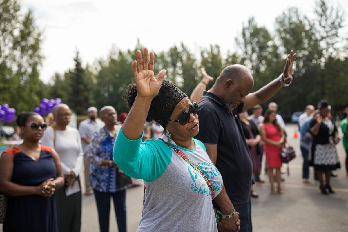 Belinda Heartwell and her husband Robert Heartwell pray during a prayer vigil Saturday, Aug. 10, 2019 at Shiloh Baptist Church. The vigil was held in response to the recent shootings in El Paso, Texas and Dayton, Ohio. (Loren Holmes / ADN)