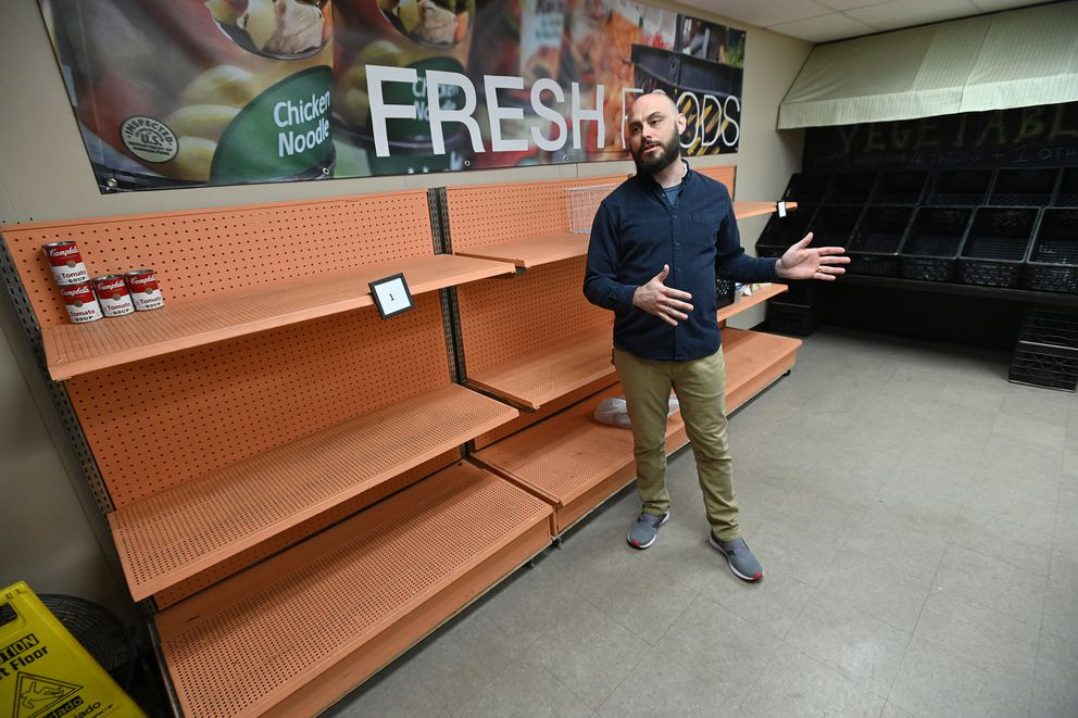 Adam Ziegler, executive director of New Hope Compassionate Ministries, had empty shelves for the first time on Wednesday, March 18, 2020, after Tuesday's food distribution. Ziegler has seen an increase in clients at their food pantry at 1220 E Street in Anchorage since the coronavirus restrictions began. (Bill Roth / ADN)