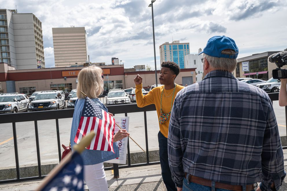 "Deven Jackson confronts a supporter of the Anchorage Police Department after a pro-police rally on Thursday, June 18, 2020 in downtown Anchorage. ""Police lives cannot matter until black lives matter,"" said Jackson. (Loren Holmes / ADN)"