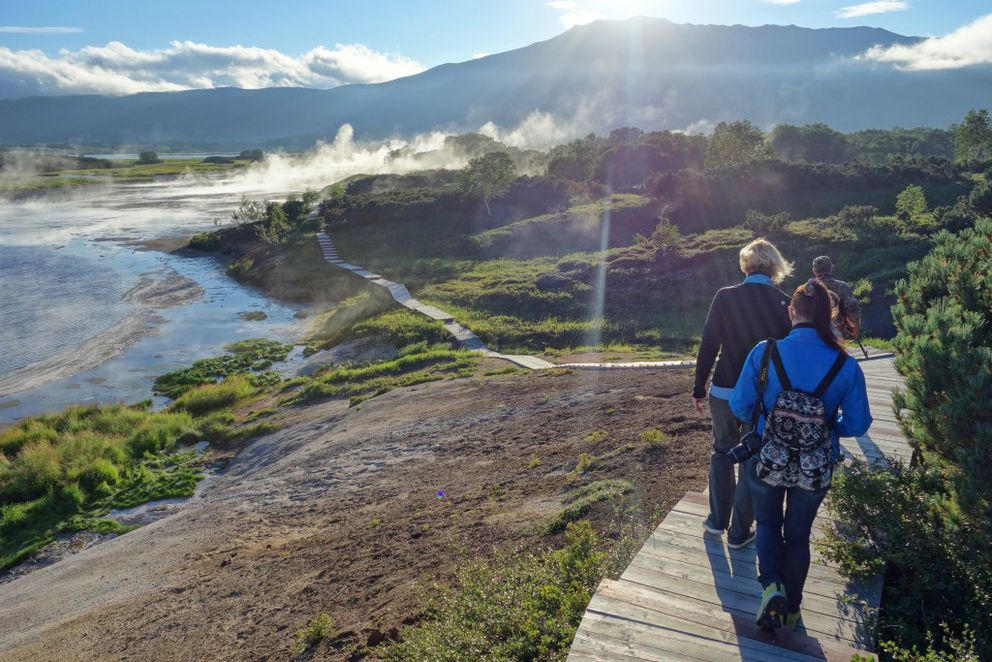 Walking on the boardwalk in the Uzon Caldera past the sulpheric acid lake. The caldera is in the Kronotsky Nature Preserve on the Kamchatka Peninsula. (Photo by Scott McMurren)