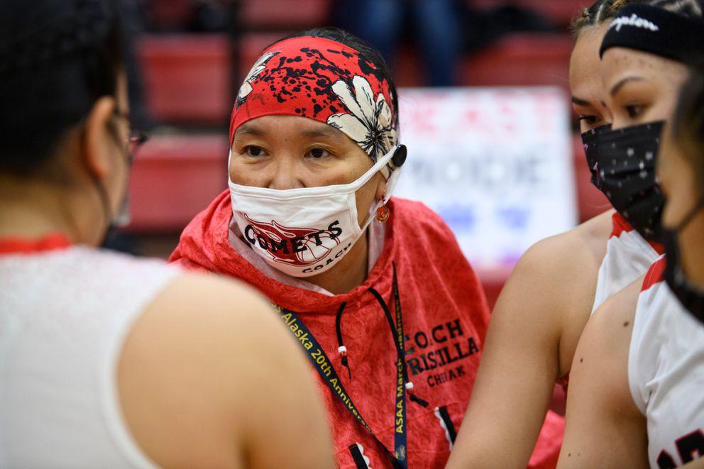 Chevak girls head coach Priscilla Matchian talks to her team. (Marc Lester / ADN)