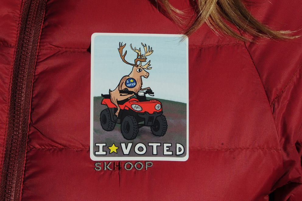 """""""I Voted"""" sticker featuring a caribou during early voting on Monday, Nov. 5, 2018. (Bill Roth / ADN)"""