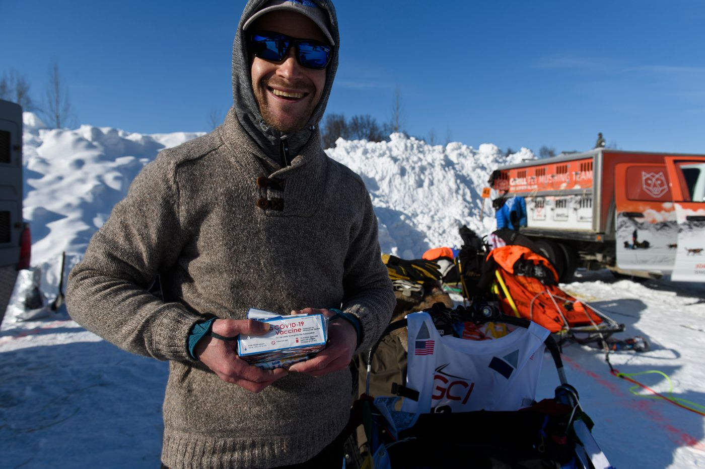 Larry Daugherty, a musher from Eagle River, will carry empty packages of COVID-19 vaccine with him on the trail this year. (Marc Lester / ADN)