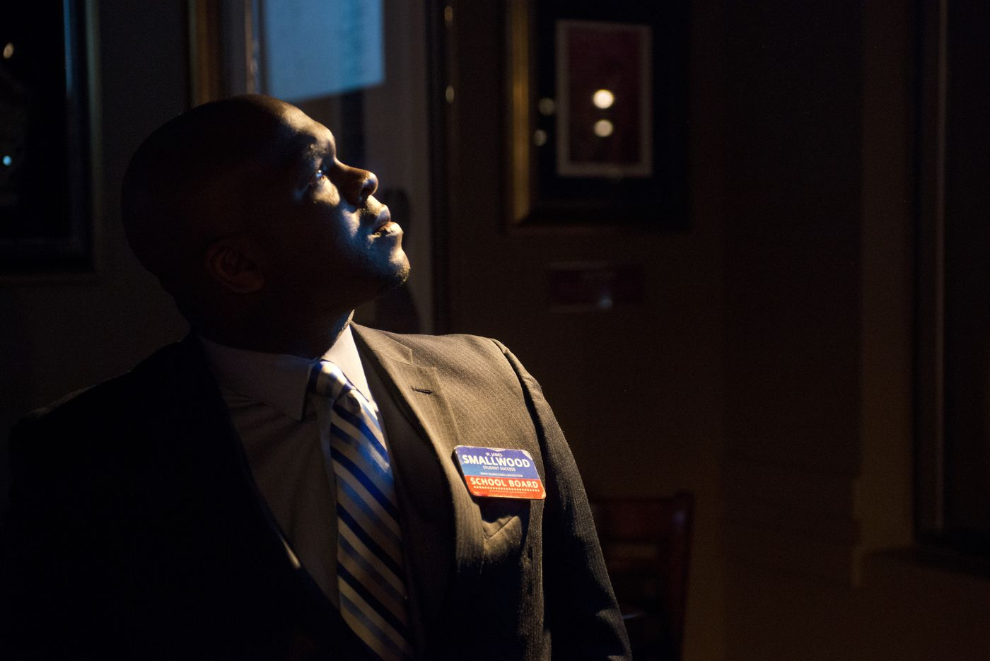 Anchorage School Board candidate James Smallwood watches results come in at Hard Rock Cafe on Tuesday. (Marc Lester / Alaska Dispatch News)