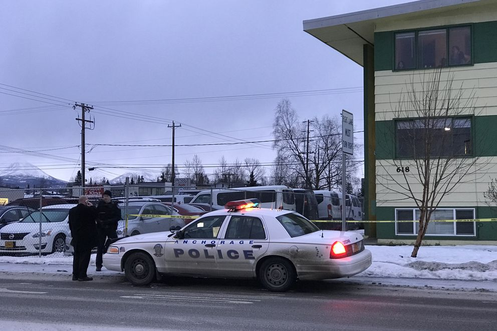 Officers at he scene of a homicide investigation at 618 E. 9th Avenue on December 10, 2017. This is the city's 34th homicide, tying with 2016 for the most homicides in one year.