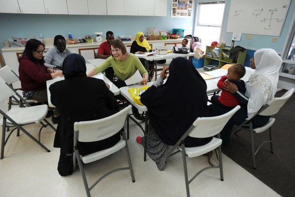 Retired ASD teacher Cindy Johnson, center, teaches a citizenship class for refugees through the Catholic Social Services on Tuesday, April 17, 2018. (Bill Roth / ADN)