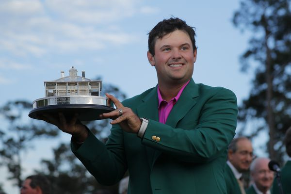 Patrick Reed of the U.S. hold the Masters Tournament Trophy and wears his green jacket after winning the 2018 Masters tournament at the Augusta National Golf Club in Augusta, Georgia, U.S. April 8, 2018. REUTERS/Brian Snyder