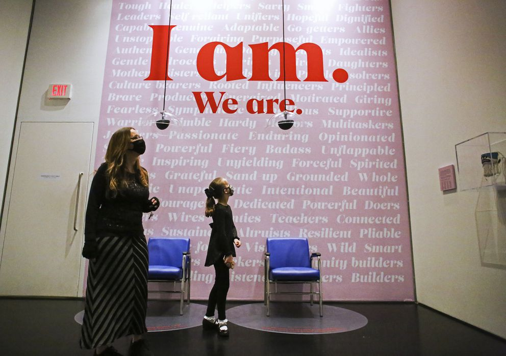 Angelica Barfield-Miner, who chose to celebrate her 11th birthday at the Anchorage Museum, walks around installations in the 'Extra Tough: Women of the North' exhibit at the Anchorage Museum with her mom, Heather Barfield, in Downtown Anchorage on Nov. 12, 2020. (Emily Mesner / ADN)