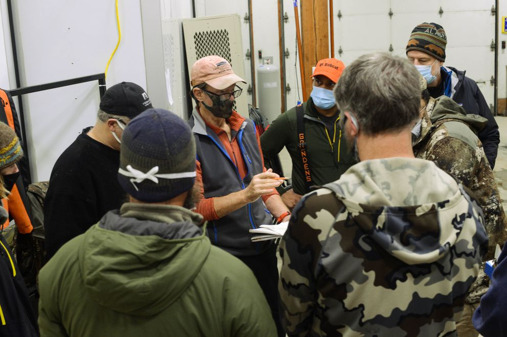 Search and rescue coordinator Dick Rice instructs waterborne search teams on their patrol areas and tidal conditions Saturday morning, Dec. 5, 2020 in Haines, Alaska. (James Brooks / ADN)