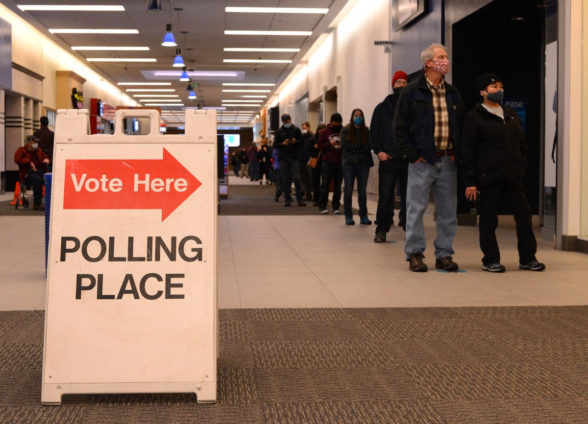 Voters wait in line to cast early ballots at Anchorage's Midtown Mall on Monday, Oct. 26, 2020. (James Brooks / ADN)