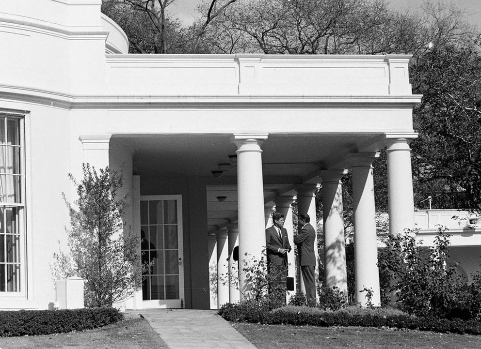 During a meeting of the Executive Committee of the National Security Council regarding Cuba, President John F. Kennedy spoke with Secretary of Defense Robert S. McNamara in the West Wing Colonnade outside the Oval Office of the White House, in Washington, Oct. 29, 1962. (Cecil Stoughton / National Archives via The New York Times)