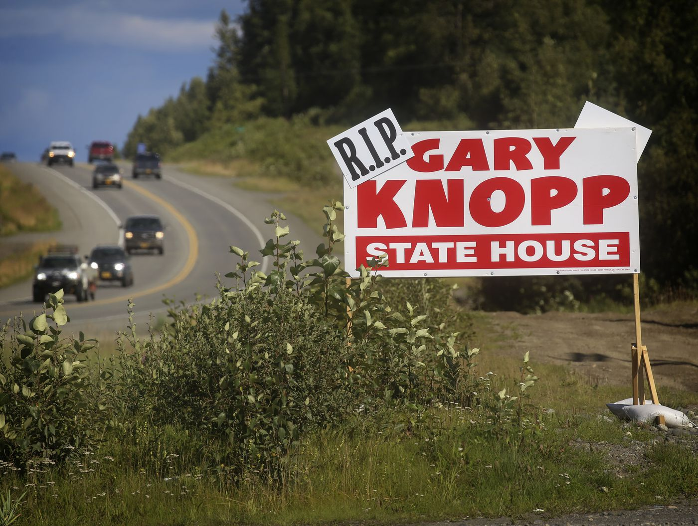A 'Rest in Peace ' sign was added to a Gary Knopp campaign sign along the Sterling Highway, photographed on Aug. 9, 2020. Knopp, a state representative, was killed in a midair plane crash above Soldotna on July 31. He was a candidate in this year's Republican primary for House District 30. (Emily Mesner / ADN)