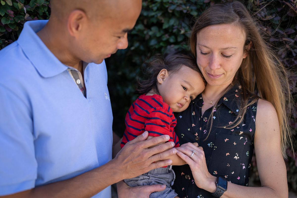 Rob and Gina Domaoal this week in Decatur, Ga., with their 20-month-old son, Eli, who picked up a virus in day care. (Photo for The Washington Post by Michael A. Schwarz)