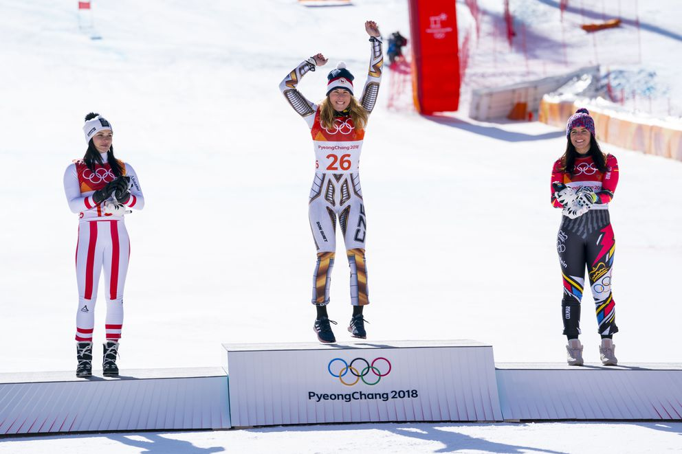Gold medalist Ester Ledecka of the Czech Republic is flanked by silver medalist Anna Veith of Austria, left, and bronze medalist Tina Weirather of Lichtenstein after the ladies' super-G event in Jeongseon, South Korea, on Friday, Feb. 17, 2018. Ledecka stunned the favorites to win the super-G and now has won gold in the snowboarding parallel slalom event. (Doug Mills/The New York Times)
