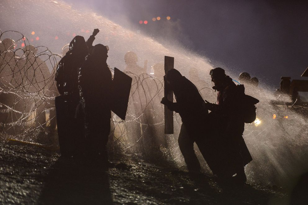 Police use a water cannon on protesters during a protest against plans to pass the Dakota Access pipeline near the Standing Rock Indian Reservation, near Cannon Ball, North Dakota, on Nov. 20. (Stephanie Keith / Reuters)