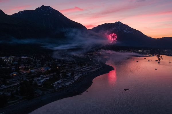 People watch Independence Day fireworks in Seward shortly after midnight on Wednesday, July 4, 2018. (Loren Holmes / ADN)