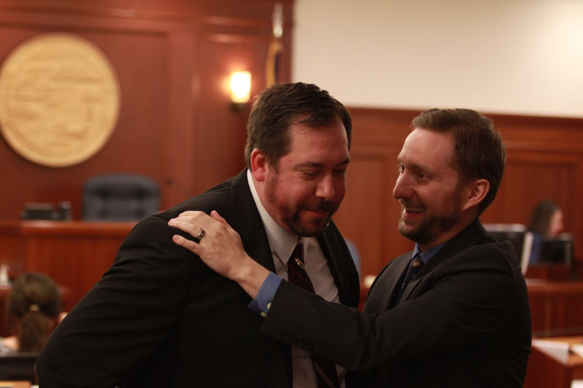 Anchorage independent Rep. Jason Grenn hugs Bethel Democratic Rep. Zach Fansler after Fansler's speech on the House floor Wednesday in support of legislation to reduce dividends and restructure the Alaska Permanent Fund. (Nathaniel Herz / Alaska Dispatch News)