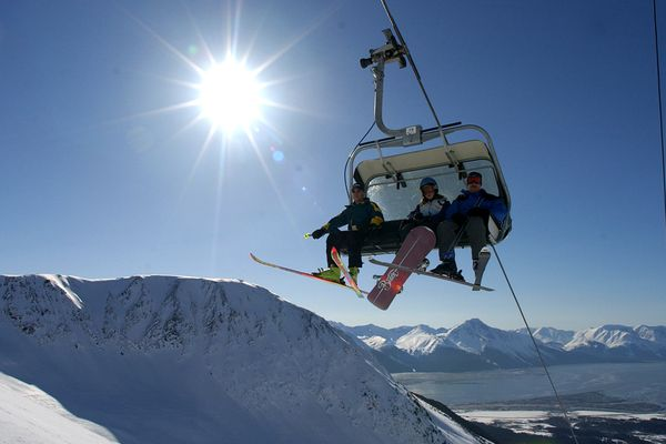 Spring skiers ride the Spirit Quad chairlift to the top of Mt. Alyeska Friday. The resort reports 13 feet of snow base at the top of the mountain. ( Jim Lavrakas/ ADN archive 2002)