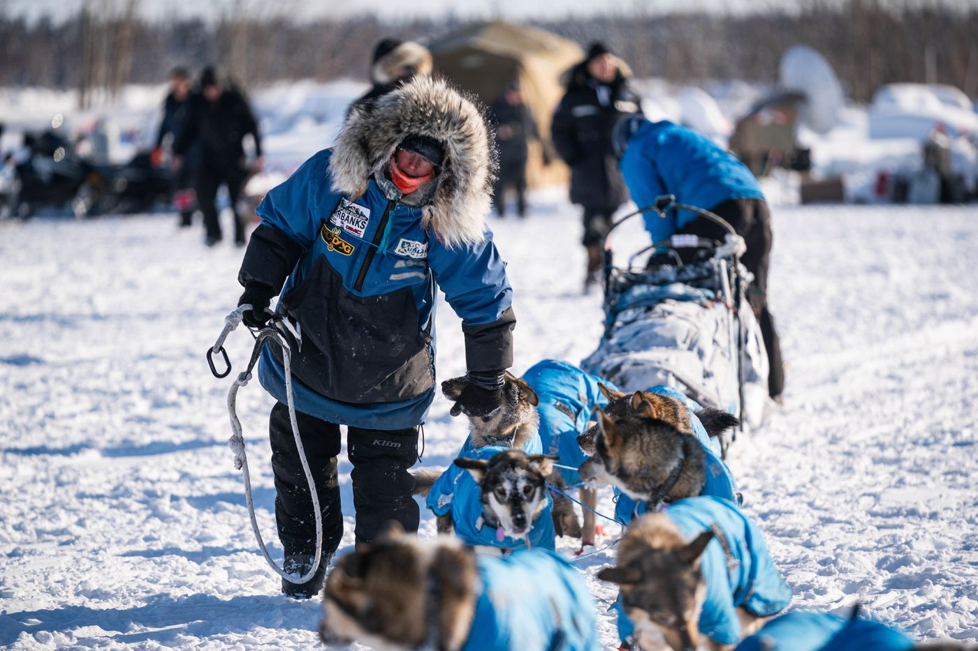 Paige Drobny secures her team after arriving in Nikolai on Tuesday, March 10, 2020 during the Iditarod Trail Sled Dog Race. (Loren Holmes / ADN)