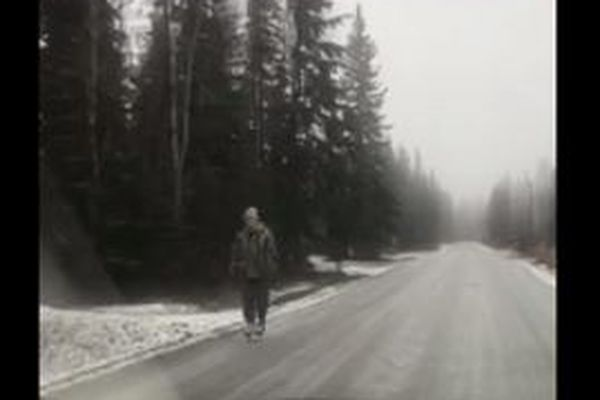 A screenshot from Wes Ford's video of a person ice skating on a road in Fairbanks on Oct. 30, 2017.