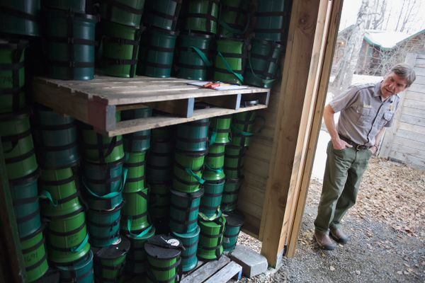 National Park Service ranger Roger Robinson shows the supply of Clean Mountain Cans stored near the Denali National Park visitors center in Talkeetna on April 20, 2018. Beginning this season, every mountain climber on Denali's West Buttress route will be required to carry a Clean Mountain Can to transport human waste. (Marc Lester / ADN)