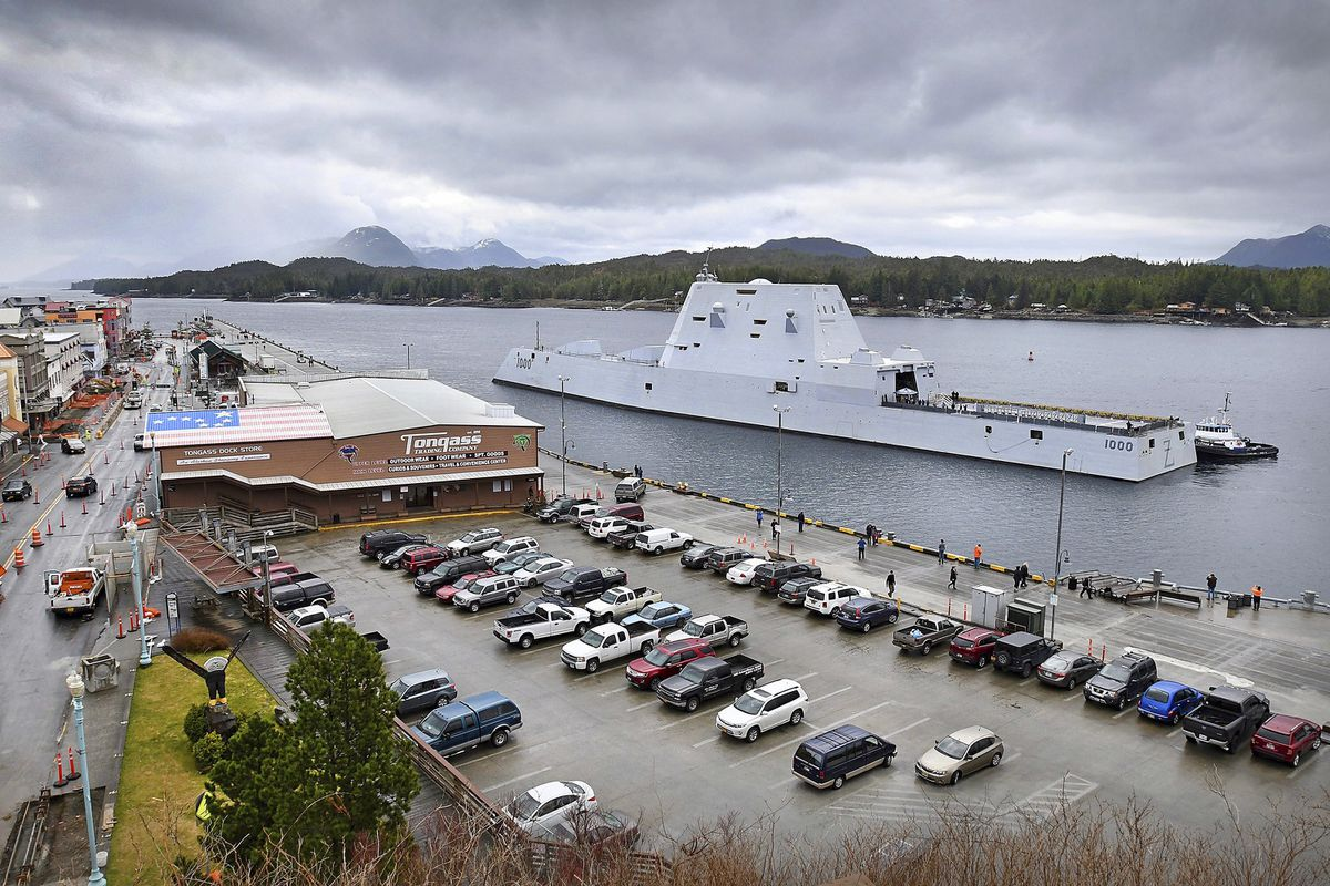 In this Saturday, March 23, 2019 photo, assisted by tugs in Tongass Narrows, the U.S. Navy guided missile destroyer USS Zumwalt approaches Berth 2 in Ketchikan, Alaska. The ship was scheduled for a multi-day visit in the First City. (Dustin Safranek/Ketchikan Daily News via AP)