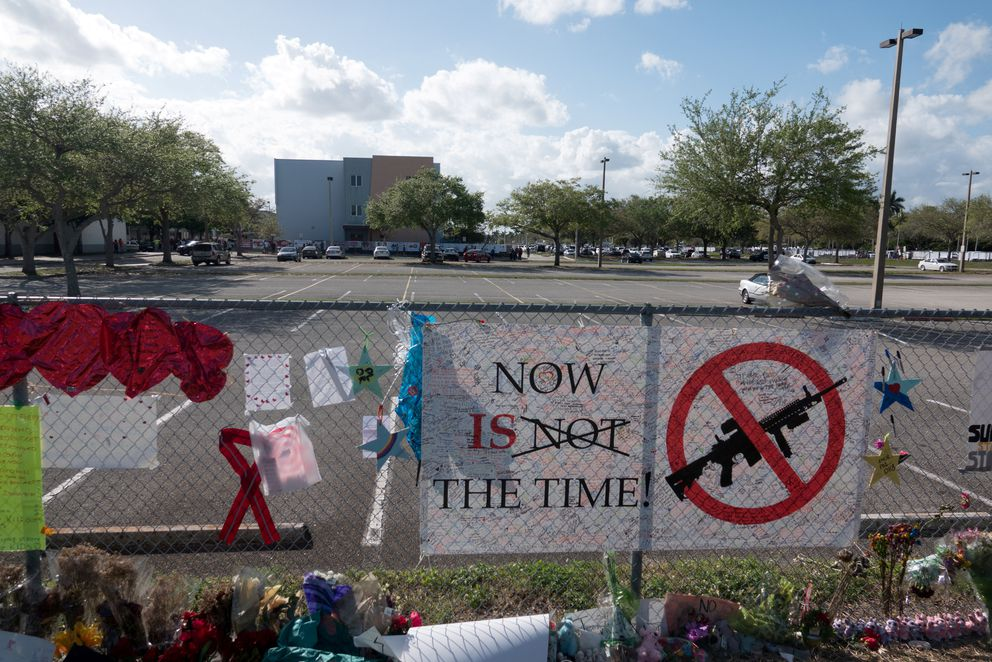 Messages posted on a fence at Marjory Stoneman Douglas High School, scene of a mass shooting in Parkland, Florida. REUTERS/Angel Valentin/File