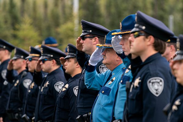 Law enforcement personnel stand at attention during the Peace Officer Memorial Day Ceremony on Friday, May 14, 2021 at the Alaska Scientific Crime Detection Lab in Anchorage. (Loren Holmes / ADN)