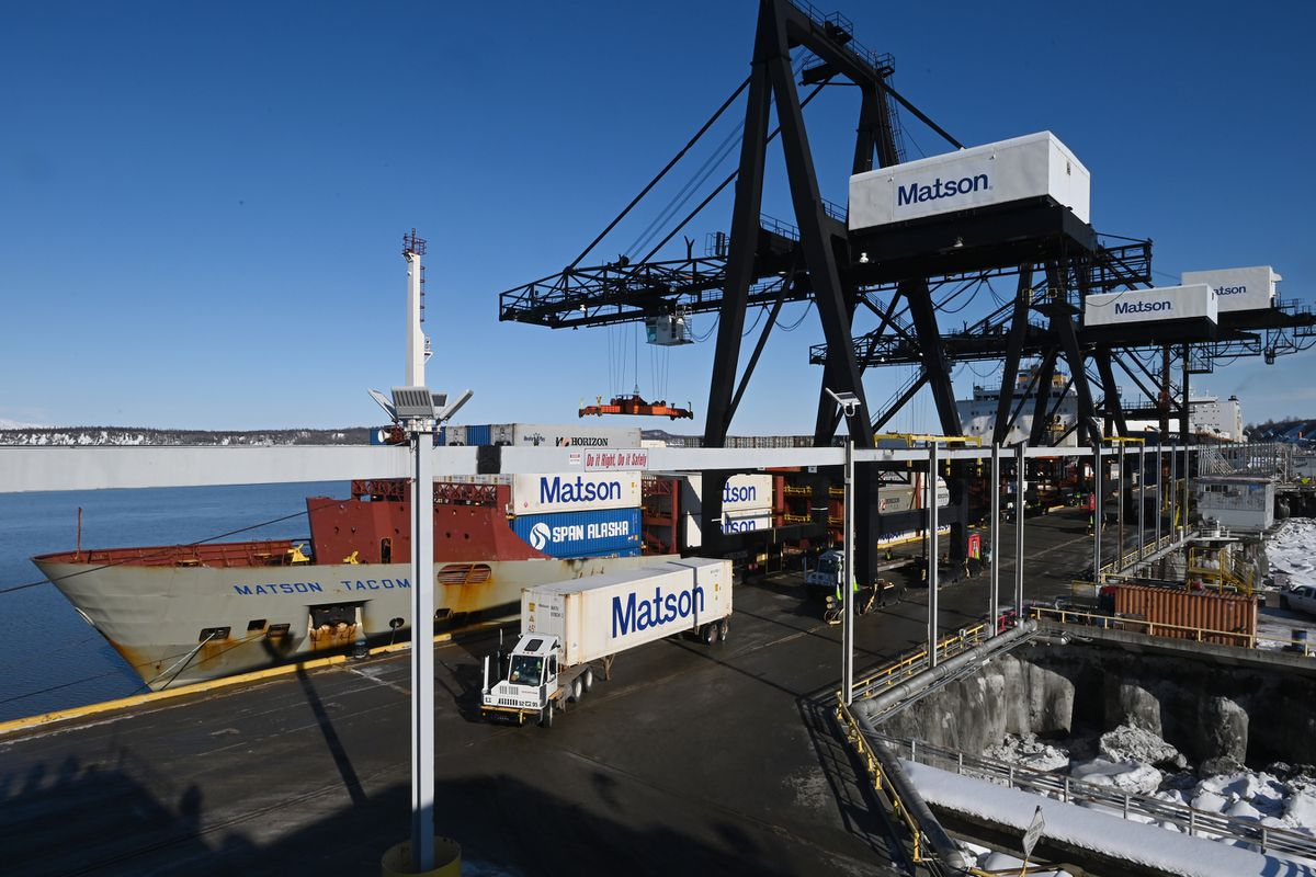 Containers are unloaded from the vessels Matson Tacoma, foreground, and TOTE Maritime's North Star, as the uninterrupted flow of goods arrived at the Port of Alaska as scheduled on Sunday, March 22, 2020. (Bill Roth / ADN)