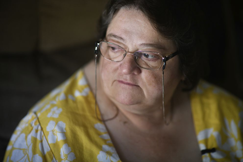 "Doris Kelley, 57, sits in her home on Monday, June 29, 2020 in Ruffs Dale, Pa. Kelley was one of the first patients in a University of Pittsburgh Medical Center trial for COVID-19. ""It felt like someone was sitting on my chest and I couldn't get any air,"" Kelley said of the disease. (AP Photo/Justin Merriman)"