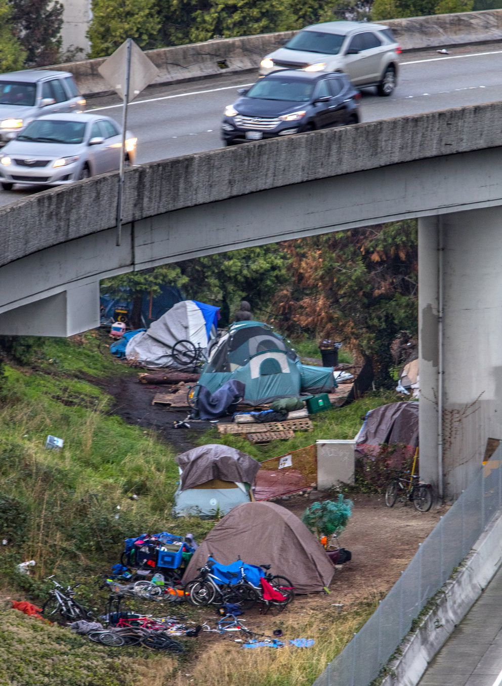 Homeless people camp under an overpass at the interchange of Interstate 5 and I-90 in Seattle on Oct. 23, 2015. (Steve Ringman / The Seattle Times / TNS file)