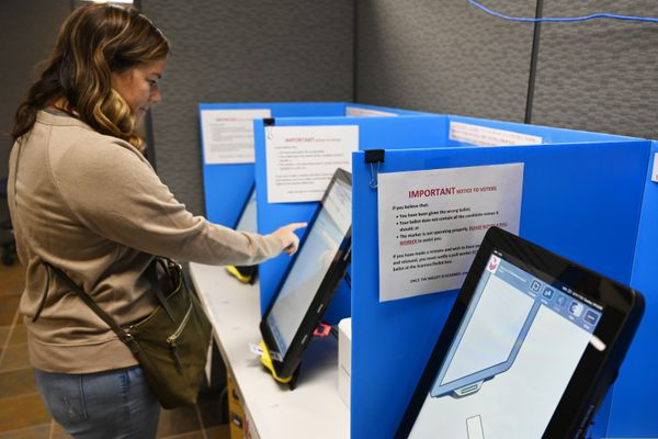 FILE-In this Tuesday, Nov. 5, 2019 file photoCourtney Parker votes on a new voting machine, in Dallas, Ga. Voting integrity advocates will try this week to convince a federal judge that the state of Georgia should scrap its touchscreen voting machines in favor of hand-marked paper ballots, while the state will ask her not to order any changes, especially so close to an election. (AP Photo/Mike Stewart, File)