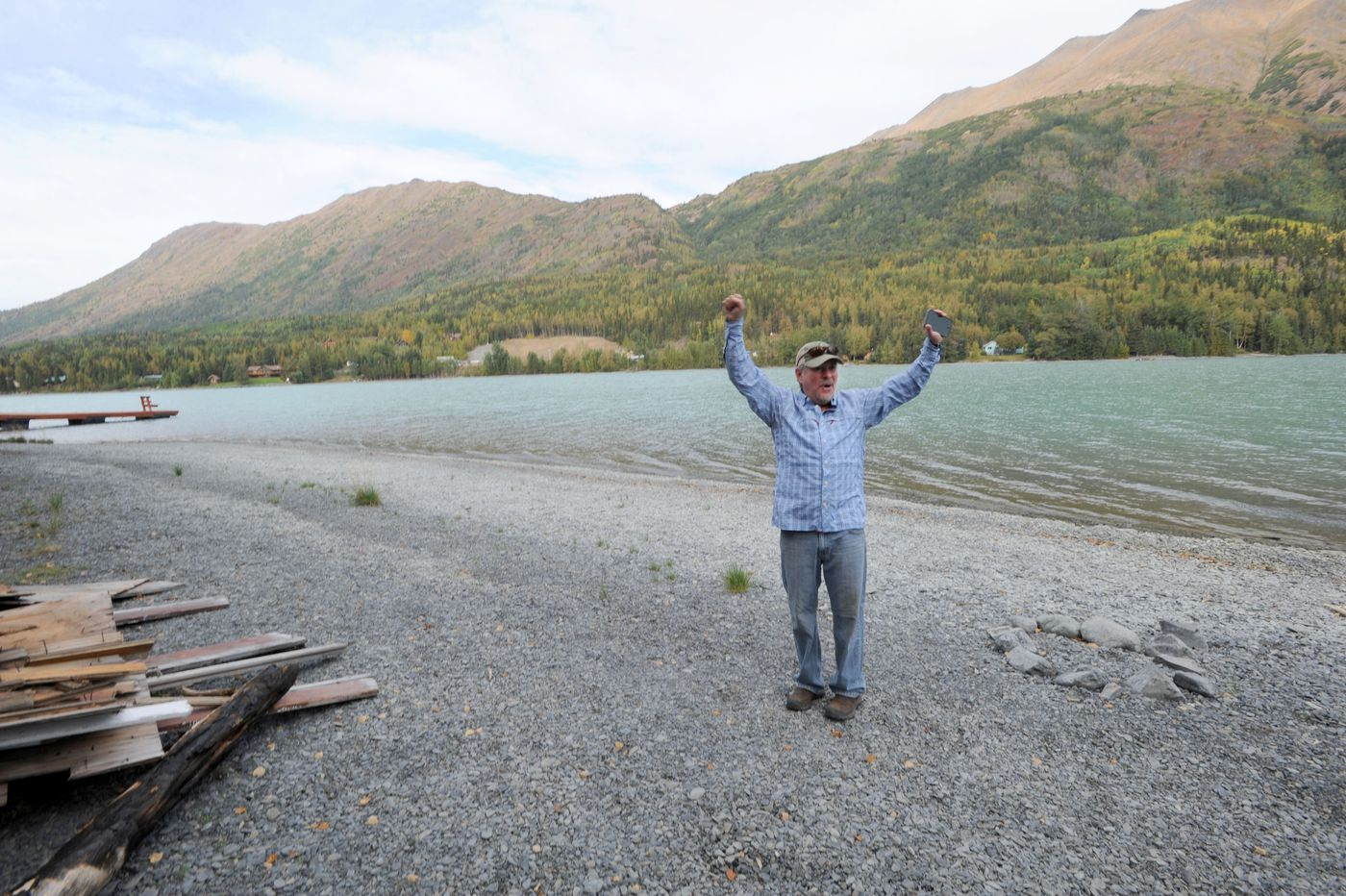 Stacy Corbin, owner of Mystic Waters Fly Fishing, talks about the day when the smoke cleared enough for air support to join the fight against the Swan Lake fire. Many people were standing along the Kenai Lake beach, cheering on the water-scooping planes. (Anne Raup / ADN)