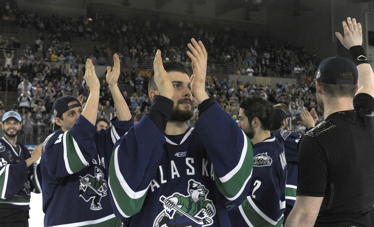 Yan-Pavel Lapiante and other Alaska Aces clap for the fans after the final game in franchise history at the Sullivan Arena on Saturday. The Aces lost to the Idaho Steelheads 3-2. (Bob Hallinen / Alaska Dispatch News)