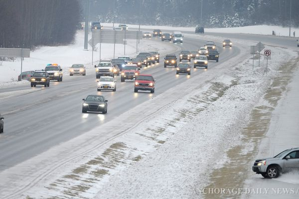 A SUV spins out into the ditch in the outbound lanes of the Glenn Highway near the Muldoon overpass as icy roads caused numerous cars to hit the ditches in Anchorage on Thursday, December 5, 2013.