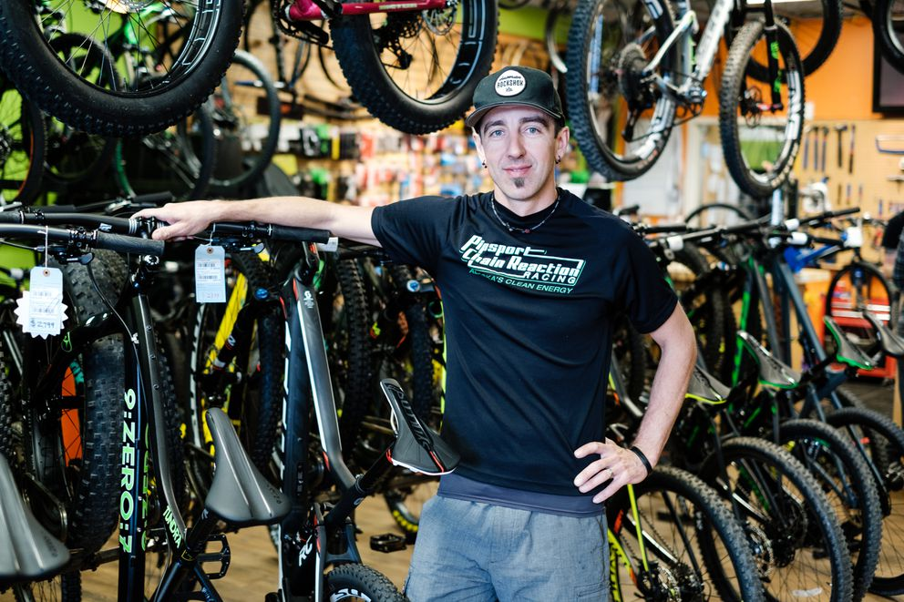James Stull stands Friday next to bicycles in his shop, which has been in its current location for 11 years. Stull plans to move his store across the street to a former fire station. (Young Kim / Alaska Dispatch News)