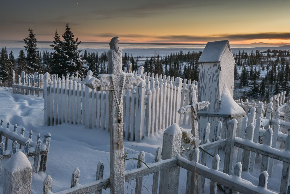 Grave sites near the edge of Great Bear Lake in Deline, a village near the Arctic Circle in Canada's Northwest Territories, Nov. 29, 2016. (Christopher Miller/The New York Times)