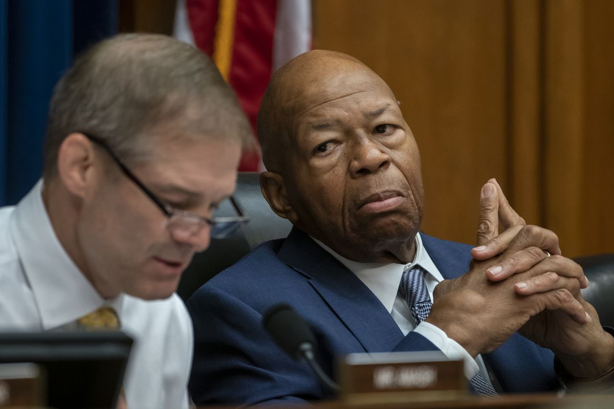 House Oversight and Reform Committee Chairman Elijah E. Cummings, D-Md., listens to an objection by Rep. Jim Jordan, R-Ohio, left, the ranking member, as they debate whether to hold Attorney General William Barr and Commerce Secretary Wilbur Ross in contempt for failing to turn over subpoenaed documents related to the Trump administration's decision to add a citizenship question to the 2020 census, on Capitol Hill in Washington, Wednesday, June 12, 2019. (AP Photo/J. Scott Applewhite)