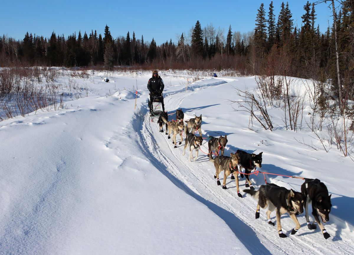 Pete Kaiser leaves the Ophir checkpoint with his dog team during the Iditarod Trail Sled Dog Race on Friday. (Zachariah Hughes/for ADN)