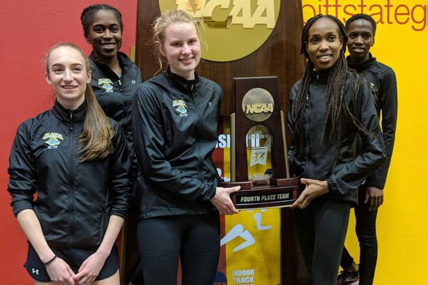 Left to right: Dani McCormick, Vanessa Aniteye, Ruth Cvancara, Caroline Kurgat and Nancy Jeptoo hold their 4th place team trophy at the NCAA Division II indoor track and field championships Saturday March 9, 2019 in Pittsburg, KS. (Photo by Ray Shadowens via UAA Athletics)