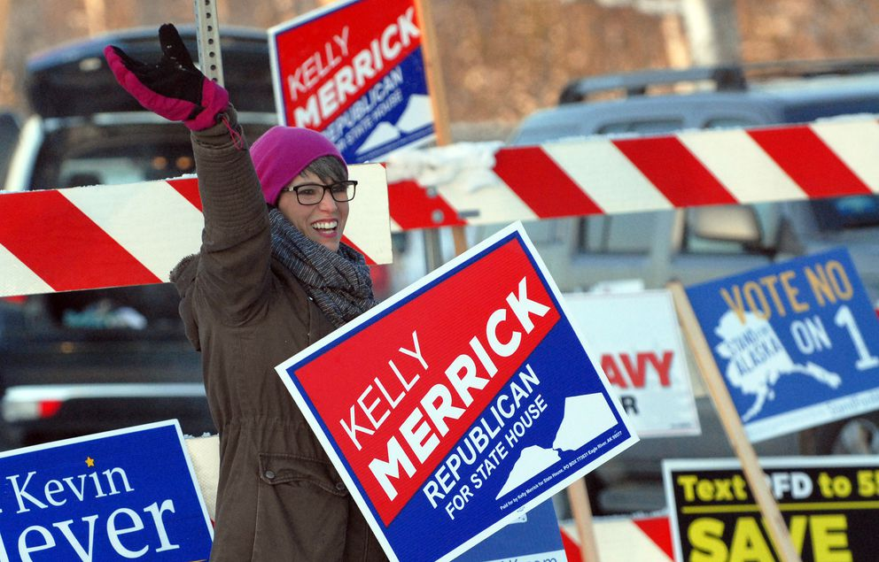 Eagle River Republican candidate for State House District 14 Kelly Merrick waves to cars alongside Hiland Road on Monday, Nov. 5, 2018. (Star photo by Matt Tunseth)