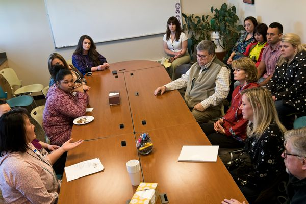 U.S. Attorney General William Barr and Sen. Lisa Murkowski, both seated near top right, listen to staff of the Tundra Women's Coalition, a shelter for victims of domestic violence and sexual assault in Bethel on May 31, 2019.(Marc Lester / ADN)