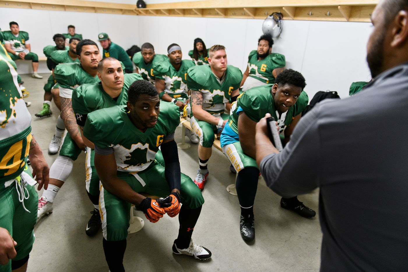 The Greatland Packers talk in the locker room at halftime of a game against the Anchorage Cowboys on Sept. 3, 2018. (Marc Lester / ADN)