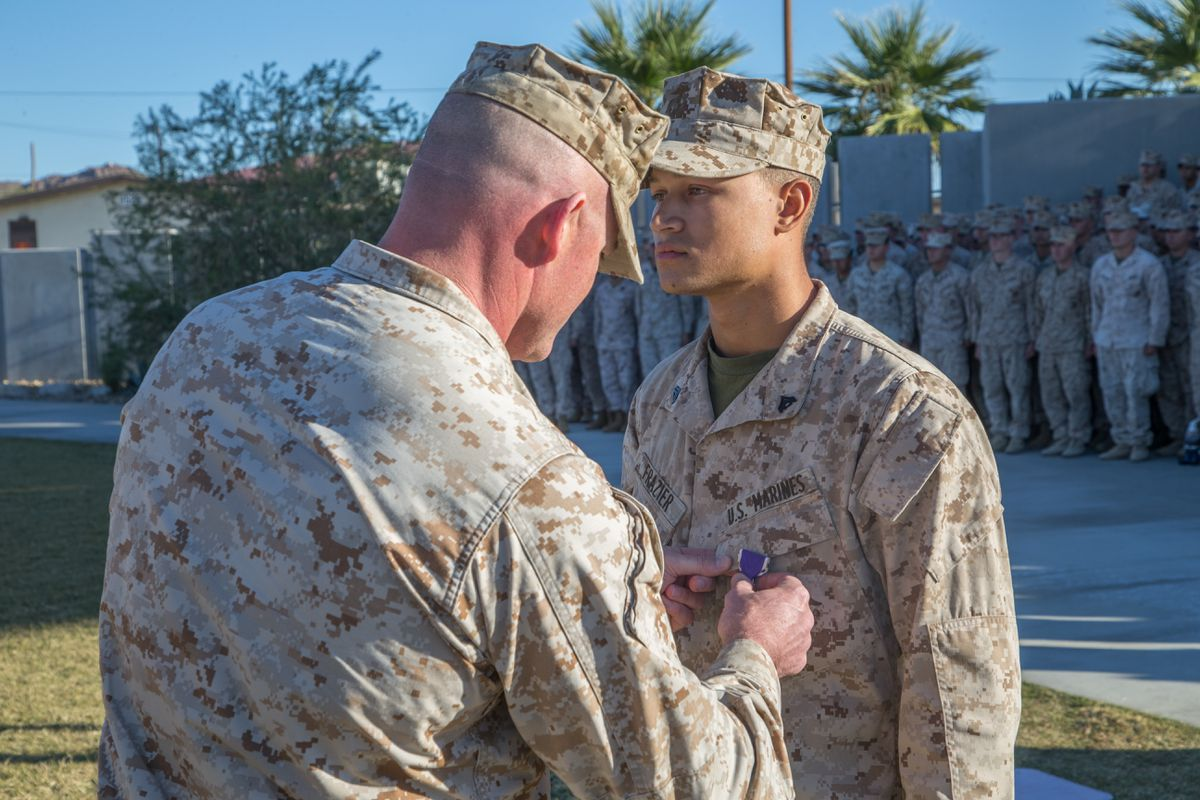 TWENTYNINE PALMS, Calif. -- Cpl. Tyler A. Frazier, a mortar Marine with 3rd Battalion, 7th Marine Regiment, is awarded the Purple Heart Medal by Lt. Col. Steven M. Ford, commanding officer, 3/7 at Victory Field aboard the Marine Corps Air Ground Combat Center, Twentynine Palms, Calif., Nov. 7, 2018. Frazier was awarded the Purple Heart for injuries sustained in Syria while 3/7 was deployed with the Special Purpose Marine Air Ground Task Force-Crisis Response-Central Command. (U.S. Marine Corps photo by Lance Cpl. Preston L. Morris)