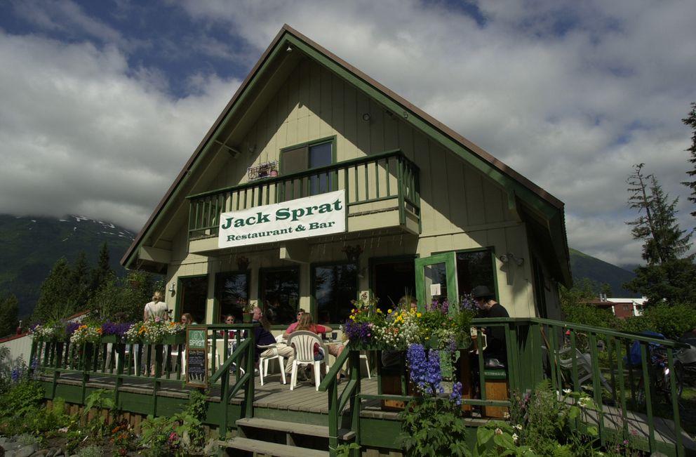Customers soak in the sun while dining on the deck Jack Sprat Restaurant & Bar in Girdwood. (Bill Roth / ADN archive)