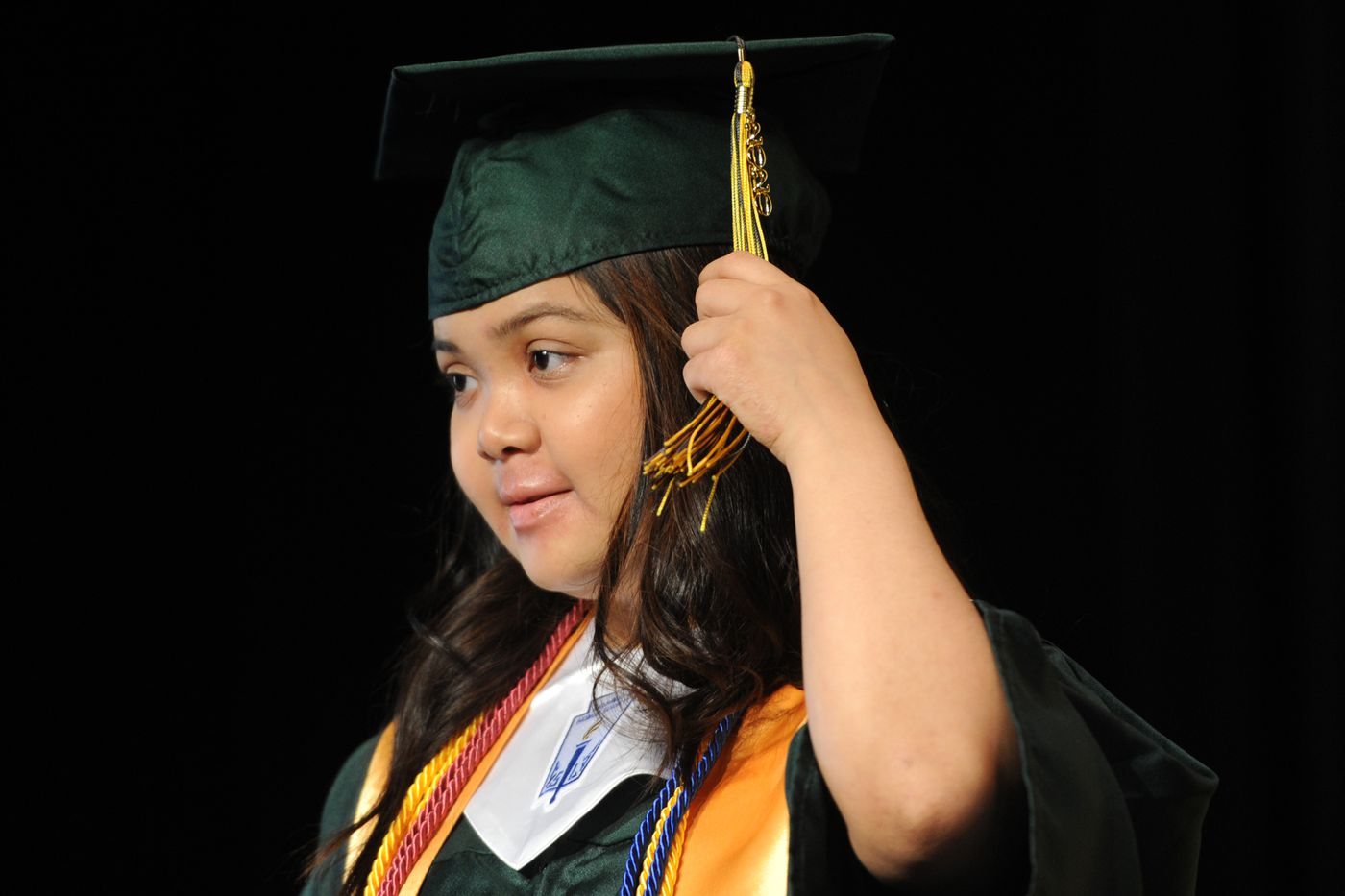 Service High School graduating senior Alexis Nicolas moves her tassel from right to left after walking across the stage on Tuesday, May 19, 2020. (Bill Roth / ADN)